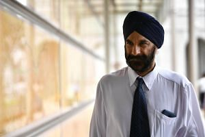 Senior Counsel Davinder Singh (pictured) asked Workers' Party chairman Sylvia Lim why the information about the firm's shareholder details were not disclosed.