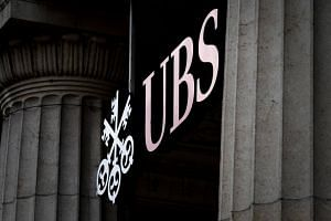 The UBS travel restriction only affected those who help manage money for clients and hadn't been imposed on other UBS business units.