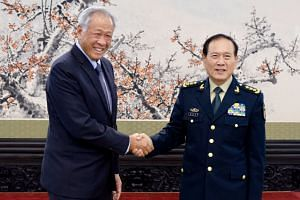 Defence Minister Ng Eng Hen with his Chinese counterpart, General Wei Fenghe, at the Bayi Building in Beijing on Oct 24, 2018.