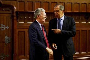 Russian Foreign Minister Sergei Lavrov (right) with US National Security Adviser John Bolton in Moscow on Monday. The Russian Security Council said later that Moscow was ready to work with the US to salvage the nuclear pact.