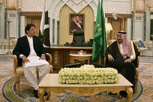 Pakistan's Prime Minister Imran Khan with Saudi King Salman during a meeting in Riyadh on Oct 23, 2018.