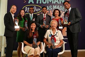 The recipients of the President's Volunteerism and Philanthropy Awards are (clockwise from back row) Associate Professor Peter Pang, representing the National University of Singapore; Ms Emily Teng, founder of Blessings in a Bag; Mr Adam Abdur Rahman
