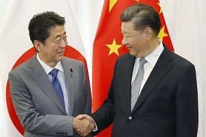 Japan's Shinzo Abe (left) and Chinese president Xi Jinping are expected to discuss how to improve economic cooperation to weather a US onslaught of trade measures.