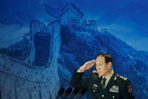 Chinese Defence Minister Wei Fenghe salutes after addressing the Xiangshan Forum in Beijing, China on Oct 25, 2018.