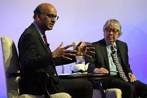 Deputy Prime Minister Tharman Shanmugaratnam at a dialogue last night moderated by Ambassador-at-large Tommy Koh at the Institute of Policy Studies' 30th anniversary dinner.