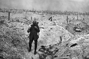 In this undated file photo released by the International Contemporary Documentation Library (BDIC), a French soldier is seen holding a human skull on a battlefield during the First World War. - Germany's far right is trying to rehabilitate the German