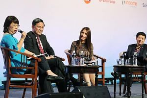Minister for Trade and Industry Chan Chun Sing at yesterday's panel discussion on income inequality and social mobility with (from left) The Straits Times' Opinion editor Chua Mui Hoong, Channel NewsAsia's senior producer and presenter for internatio