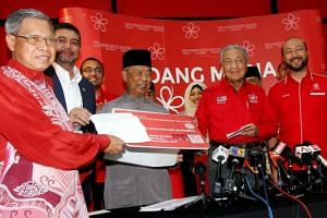 Former Umno stalwart Mustapa Mohamed (left) submitting his application to join Parti Pribumi Bersatu Malaysia on Oct 27, 2018.