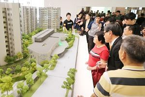 Potential buyers examining a scale model of The Woodleigh Residences launch on Oct 27, 2018.