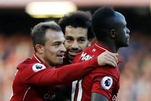 Liverpool's Sadio Mane celebrates scoring their fourth goal with Xherdan Shaqiri and Mohamed Salah.