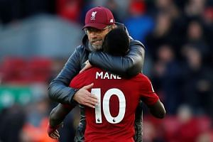 Liverpool manager Juergen Klopp embraces Sadio Mane at the end of the match.