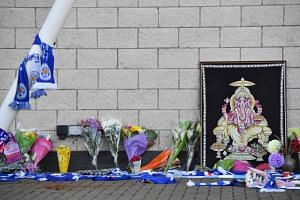 Scarves, flowers as well as an image of Ganesh - a Hindu god often found at Thai Buddhist temples - are left at a tribute site outside Leicester City Football Club's King Power Stadium, on Oct 28, 2018.