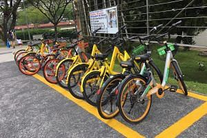 Shared bikes from Mobike, Grab and Ofo parked in Clementi Road on April 4, 2018. The Land Transport Authority said it received licensing fees from six firms which will together operate 40,500 shared bikes.