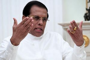 Sri Lanka President Maithripala Sirisena (pictured) sacked PM Ranil Wickremesinghe and swore in ex-president Mahinda Rajapaksa to replace him.