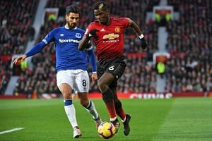 Manchester United's French midfielder Paul Pogba (right) vies with Everton's Portuguese midfielder André Gomes during the EPL match at Old Trafford in Manchester, north west England, on Oct 28, 2018.