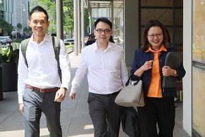 (From left) Town councillors Kenneth Foo and Chua Zhi Hon with Workers' Party chairman Sylvia Lim at the Supreme Court on Oct 29, 2018.