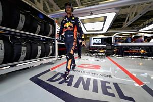 Red Bull's Daniel Ricciardo walks out of the garage before the Mexican Grand Prix at Autodromo Hermanos Rodriguez in Mexico City on Oct 28, 2018.