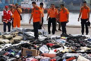 Recovered belongings believed to be from the crashed Lion Air flight JT610, at Tanjung Priok port in Jakarta on Oct 30, 2018. FlightRadar24 reported unusual airspeeds and altitudes in the few minutes that the flight was in the air.