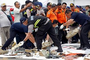 Rescue workers lay out newly recovered debris of Lion Air Flight JT610 at Tanjung Priok port in Jakarta, on Oct 30, 2018.