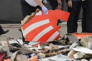 An aircraft part from the Lion Air flight JT-610 plane crash at Tanjung Priok Harbour, on Oct 30, 2018.
