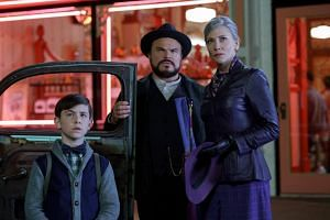 Owen Vaccaro (left) plays the lead role in The House With A Clock In Its Walls with Jack Black and Cate Blanchett.