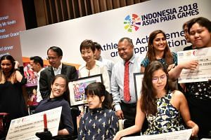 Minister for Culture, Community and Youth Grace Fu with para athletes at the Athletes' Achievement Awards on Oct 31, 2018.