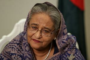 Hasina (above) hosted members of the opposition coalition at her Dhaka residence.