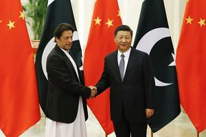 Chinese President Xi Jinping (right) with Pakistani Prime Minister Imran Khan during their meeting at the Great Hall of the People in Beijing, on Nov 2, 2018.