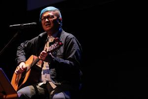 Local author-musician Kelvin Tan performing at the opening of the 21st edition of the Singapore Writers Festival on Nov 2, 2018.