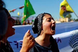 A Syrian Kurdish protester chants slogans on Nov 1, 2018, against Turkish attacks on Kurdish militia posts in northern Syria.