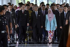 Malaysian Prime Minister Mahathir Mohamad (centre), flanked by Finance Minister Lim Guan Eng and Deputy Prime Minister Wan Azizah Wan Ismail, arriving for the budget presentation in Kuala Lumpur yesterday.