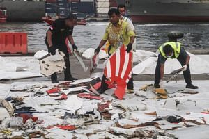 Debris of Lion Air flight JT 610 that is being moved for the investigation by the National Transportation Safety Committee at Tanjung Priok port in Jakarta, Indonesia, on Nov 2, 2018.