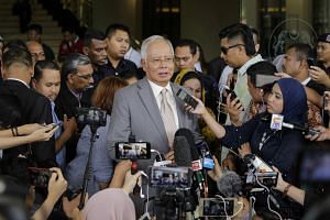 Former Malaysia premier Najib Razak speaking to the media outside the Kuala Lumpur courts last week. He has been hit with 38 charges - mostly linked to the alleged looting of 1MDB.