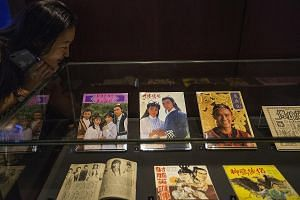 Memorabilia on display at the Jin Yong Gallery in Hong Kong Heritage Museum. Martial arts novelist Louis Cha's works have been adapted into movies, TV dramas, radio serials and even video games over the years.