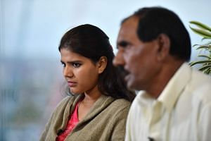 Ashiq Mesih (right) and Eisham Ashiq, the husband and daughter of Asia Bibi, speak during an interview with AFP in London.