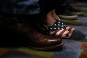 A supporter wears patriotic shoes as US Senator Ted Cruz speaks during a Get Out The Vote Bus Tour rally on Nov 3, 2018 in Corpus Christi, Texas.