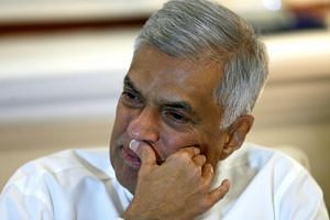 Sri Lanka's deposed Prime Minister Ranil Wickremesinghe said his abrupt dismissal raised doubts about the future of democracy in the island.