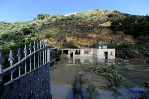 A flooded house where nine people of the same family died after a small river burst its banks in Casteldaccia near Palermo on the southern Italian island of Sicily.