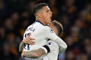 Erik Lamela celebrating with Kieran Trippier after scoring the first of Tottenham's three goals on Saturday. Wolverhampton Wanderers later scored two penalties with 11 minutes to go but Spurs held on to win 3-2.