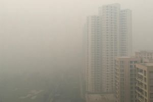 Residential buildings are seen shrouded in smog in Noida on the outskirts of New Delhi, India, on Nov 5, 2018.