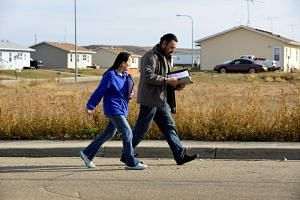 Michelle Chasing Hawk and Ira Hanson canvass voters in Porcupine, North Dakota, ahead of the 2018 midterm elections on the Standing Rock Reservation, US, on Oct 26, 2018.