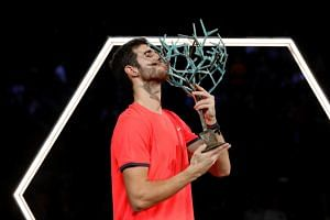 Russia's Karen Khachanov celebrates with the trophy after winning the final against Serbia's Novak Djokovic (not pictured) at the AccorHotels Arena, Paris, France, on Nov 4, 2018.
