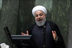 Iranian President Hassan Rouhani told economists at a meeting his country will break sanctions reimposed by the US on its vital energy and banking sectors.