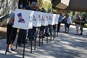 Americans casting their ballots at outdoor booths during early voting for the midterm elections last Saturday in Pasadena, California.