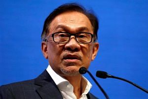 Malaysia's leader-in-waiting Anwar Ibrahim said there are ongoing discussions about recovering money from financial institutions including Goldman.