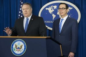 US Secretary of State Mike Pompeo (left) and US Treasury Secretary Steven Mnuchin hold a news conference during which they announced sanctions against Iran, at the Foreign Press Center in Washington, DC, US, on Nov 5, 2018.