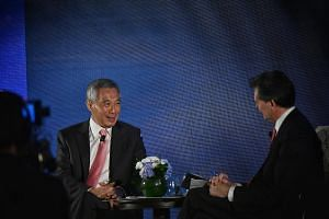 Prime Minister Lee Hsien Loong at a dialogue last night hosted by Bloomberg News' editor-in-chief John Micklethwait during a dinner for around 400 top business and thought leaders attending the Bloomberg New Economy Forum.