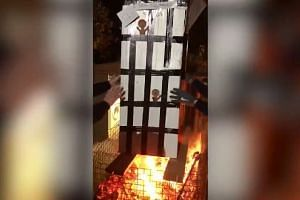 A screenshot shows the Grenfell Tower effigy being placed on the bonfire.