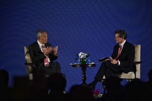 Prime Minister Lee Hsien Loong at a dinner dialogue, moderated by Bloomberg News' editor-in-chief John Micklethwait, for leaders attending the Bloomberg New Economy Forum on Nov 6, 2018.