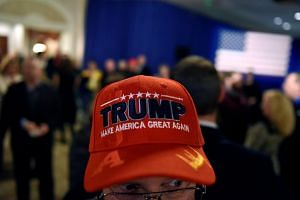 A supporter wearing a Donald Trump hat at a midterm election party in Wisconsin on Nov 6, 2018. The Republicans gained in two states that overwhelmingly supported Mr Trump in 2016.